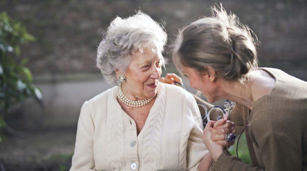 Elderly woman with helper